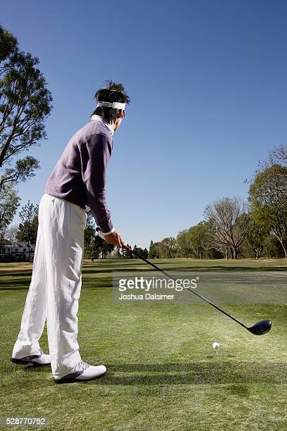 Man Preparing to Tee Off