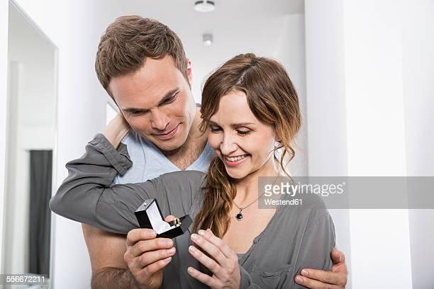 Man presenting his girlfriend a ring