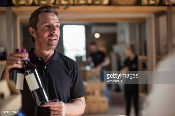 Man presenting wine in shop