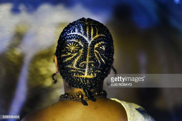 A man presents an AfroColombian hairstyle during the 12th contest of Afro hairdressers Tejiendo Esperanzas in Cali Valle del Cauca department...