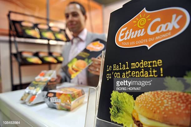 A man presents on a a range of ethnic products including Halal food on stand Ethni Cook on October 14 2010 during the VAE EXPO fair of takeaways and...