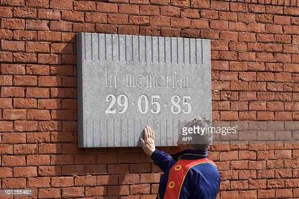 A man presses his hand against a plaque commemorating the Heysel stadium disaster on the 25th anniversary in Brussels on May 29 2010 The Heysel...