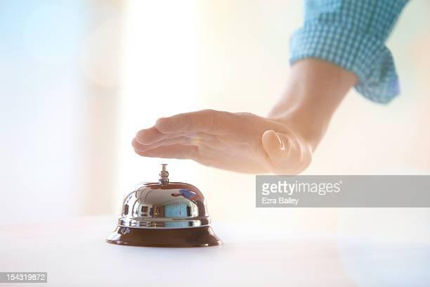 Man pressing a reception bell.