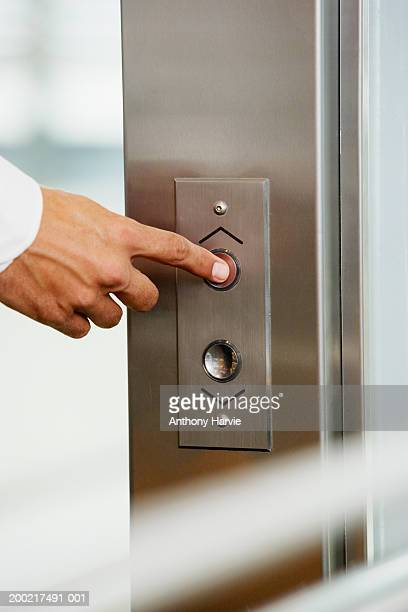 Man pressing button for elevator