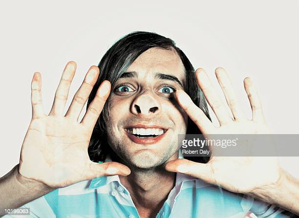 man pressing face and hands on glass, close-up, portrait - pushing stock pictures, royalty-free photos & images