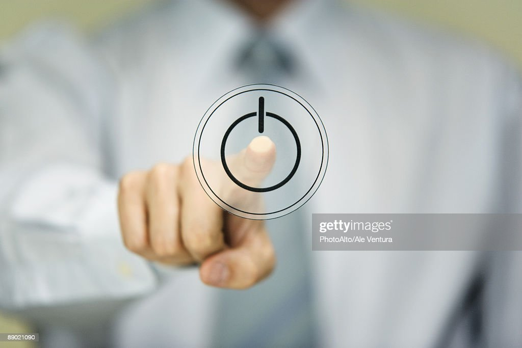 Man pressing power button