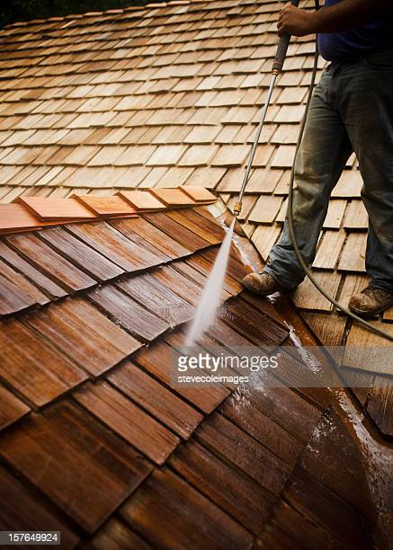 man pressure washing a roof - roof stock pictures, royalty-free photos & images
