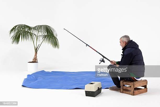 A man pretend fishing in pretend water