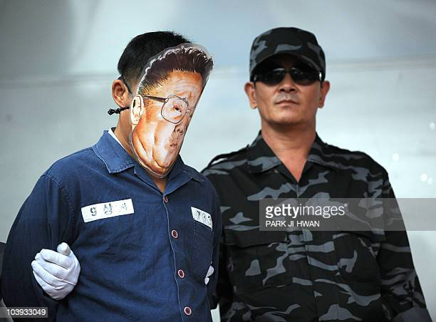 A man pretending to be North Korean leader Kim JongIl is led to a firing squad for execution during a stage performance on September 9 2010 in Seoul...