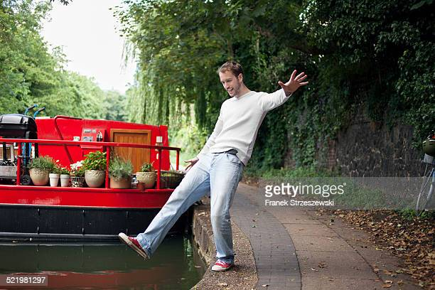 Man pretending to fall into canal , East London, UK