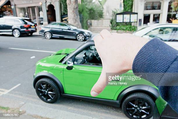 man pretending to hold car - nancy green stock pictures, royalty-free photos & images