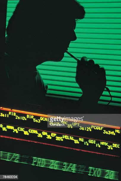 Man profile with stock market ticker