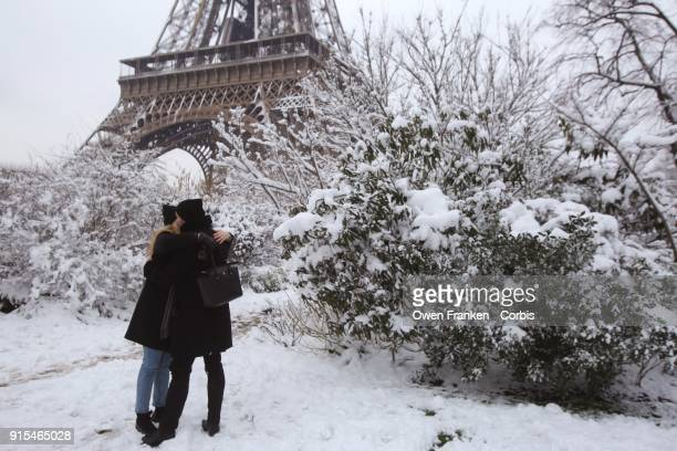 A man proposes marriage to his girlfriend and she accepts as snow falls on February 7 2018 in Paris France According to the weather forecast it will...