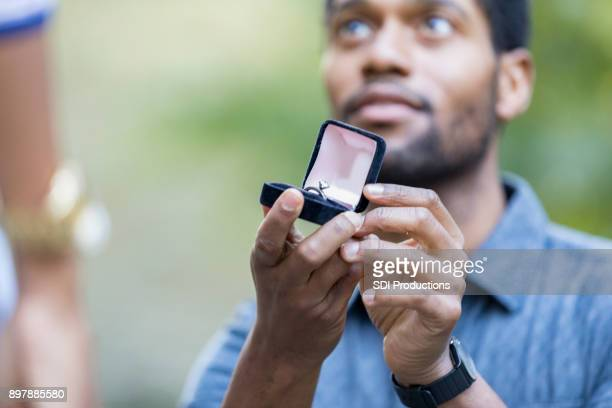 man proposes to girlfriend - engagement stock pictures, royalty-free photos & images