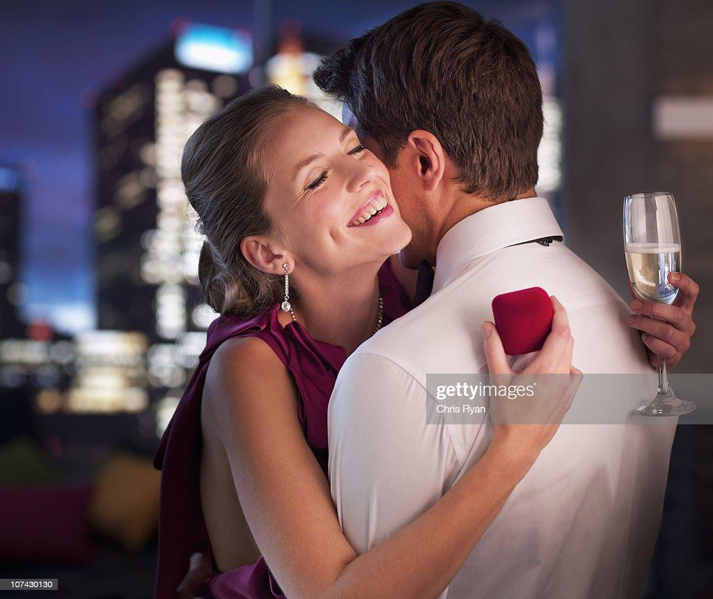Man proposing engagement to girlfriend : Stock Photo