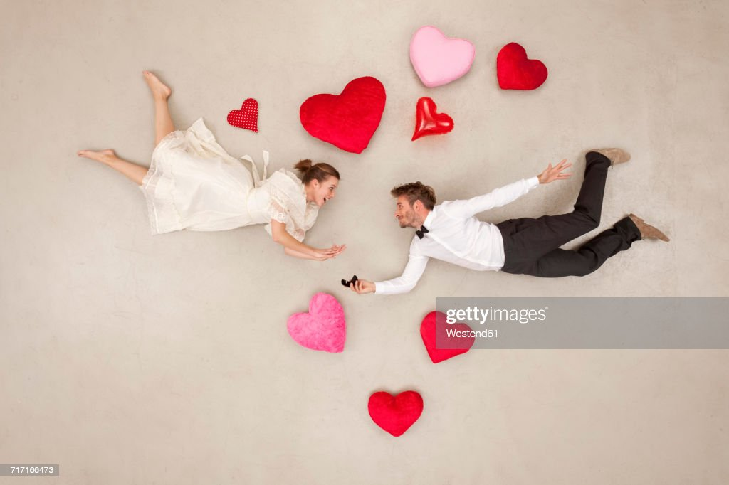 Man Proposing To Woman With Hearts Around Stock Photo Getty Images