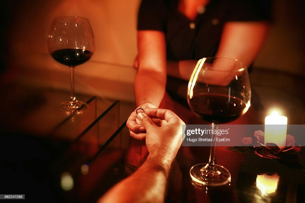 Man Proposing Woman With Engagement Ring At Restaurant Table : Stock Photo