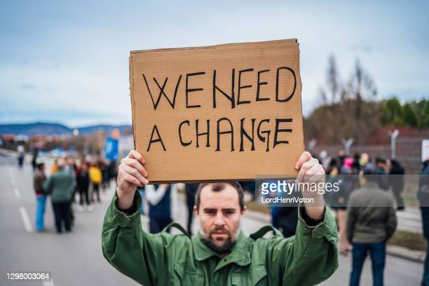 man protesting at the street - protestor stock pictures, royalty-free photos & images
