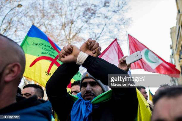 A man protesting calling for the release of political prisoners in the Rif region of Morocco during a demonstration where hundreds of people from all...