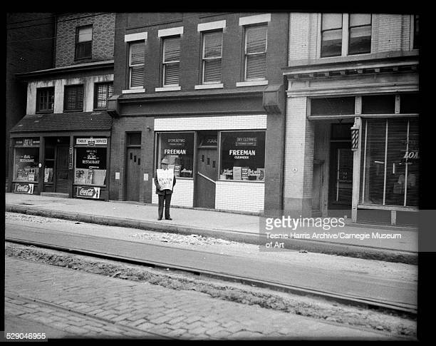 Man protesting nonunion labor in front of Freeman Cleaners between Ruth's Restaurant and Loar's Barber Shop 7353 Frankstown Avenue Homewood...