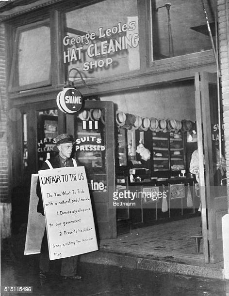 Man protesting outside of a business owned by a Jehovah's Witness During the early part of the 20th century Jehovah's Witnesses were frequently...