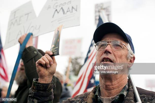A man protesting the FBI's presence at the Malheur National Wildlife Refuge holds up a constitution during a protest at the Harney County Courthouse...