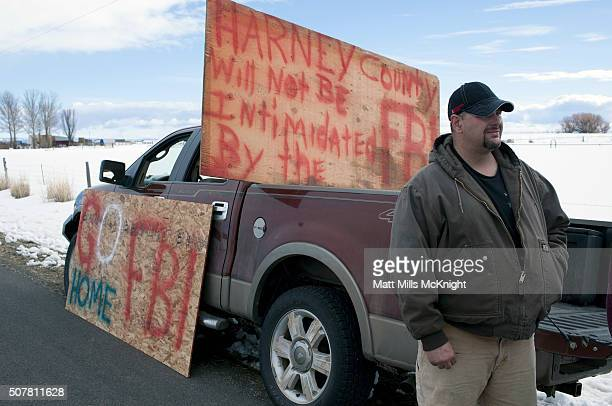 A man protesting the FBI's presence in Harney County stands adjacent to Burns Municipal Airport near Burns Oregon on January 31 2016 Eight protestors...