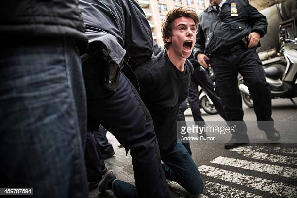 Man protesting the Ferguson grand jury decision to not indict officer Darren Wilson in the Michael Brown case is arrested while marching through the...