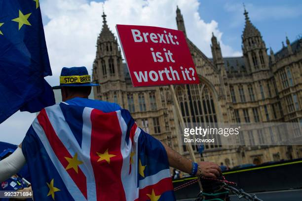A man protests against Brexit outside the Houses of Parliament on July 5 2018 in London England A prolonged heatwave continues to grip much of the...