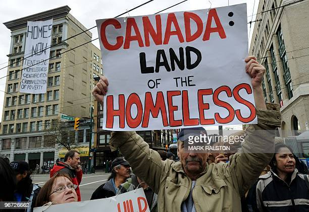 Man protests against homelessness near the newly opened Olympic Tent Village which will house the homeless in donated tents as a protest against the...