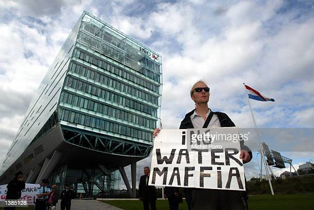 Man protests against the role that Dutch ING Bank plays in the privatization of water in Cochabamba, Bolivia September 16, 2002 outside of ING House,...