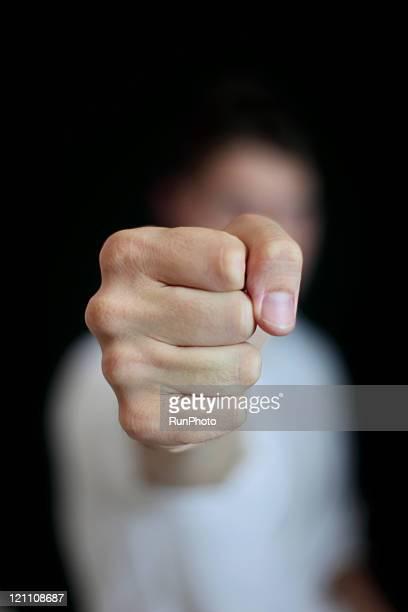 man protruding fist