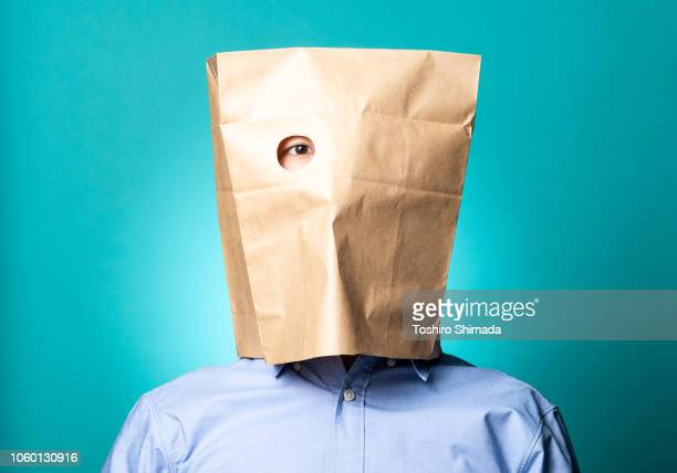 Image result for images of whistleblower with paper bag over his head