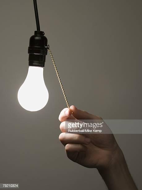 Man pulling light switch