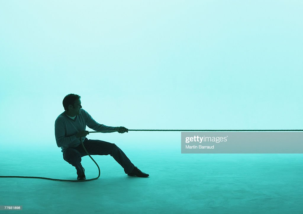 Man pulling on a rope : Stock Photo
