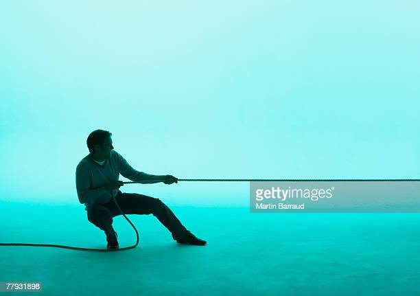 Man pulling on a rope