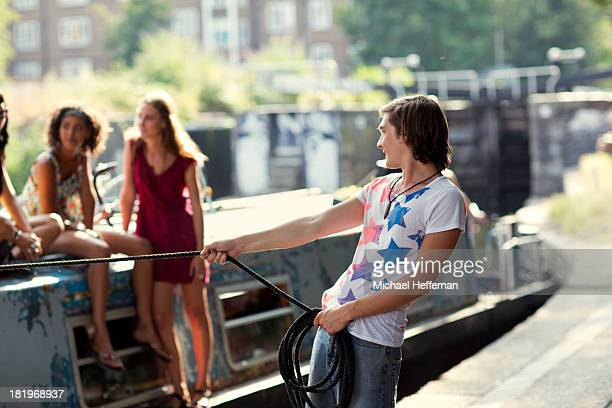 man pulling on canal boat rope