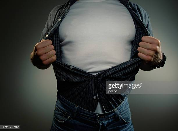 Man Pulling Open Shirt To Reveal White T Shirt