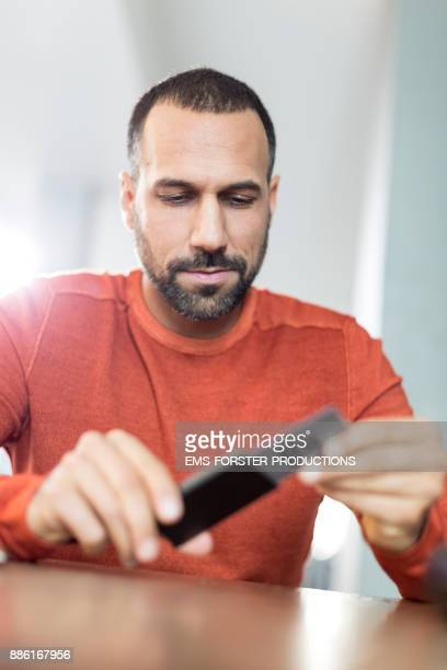 man pulling out his credit card