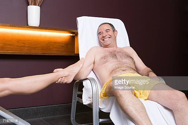 man pulling woman's leg - female hairy chest stock pictures, royalty-free photos & images