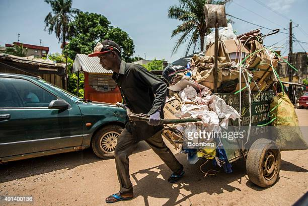 A man pulls a cart loaded with cardboard and other materials through the streets of Conakry Guinea on Wednesday Sept 9 2015 With 43 percent of its...