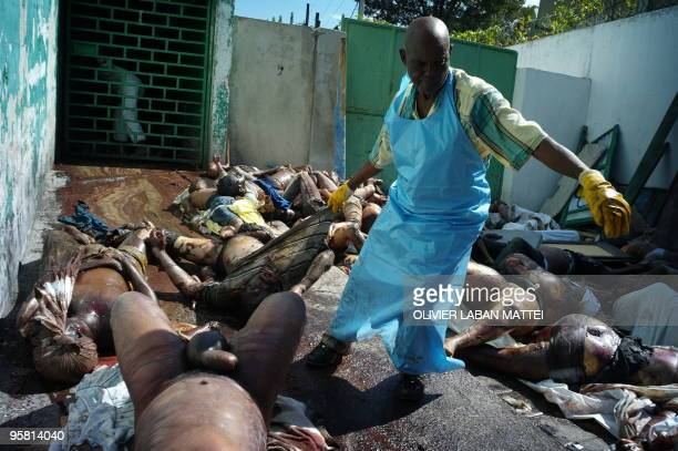 A man pulls a dead body at the morgue of the general hospital January 15 2010 at Port Au Prince following the 70magnitude quake on January 12 More...
