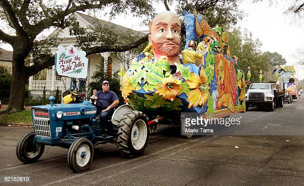 A man pulls a float on a tractor during the historic Proteus parade founded in 1882 during Mardi Gras festivites February 7 2005 in New Orleans...
