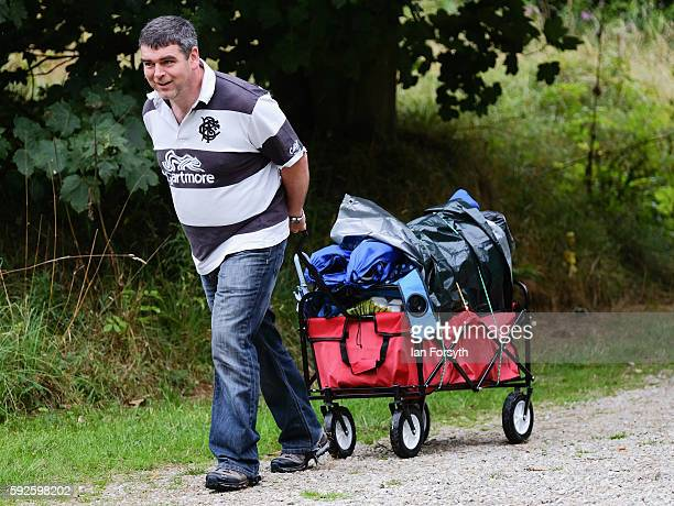 A man pulls a trolley as he arrives for the start of the annual classical Proms Spectacular concert held on the north lawn of Castle Howard on August...