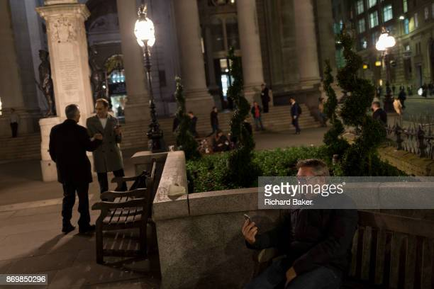 A man pulls faces during a live stream with family amid the bustle of Cornhill in the Square Mile the heart of the capital's historical financial...
