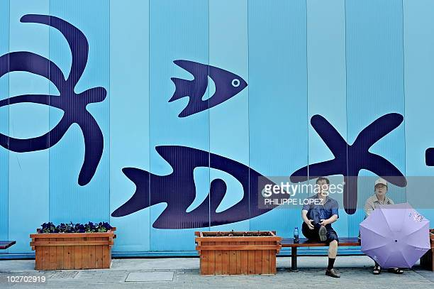 A man pulls his pants up as he takes a break in front of the Oceania pavilion at the World Expo 2010 in Shanghai on May 3 2010 The World Expo in...