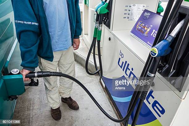 Man pumping fuel into his vehicle at BP service station