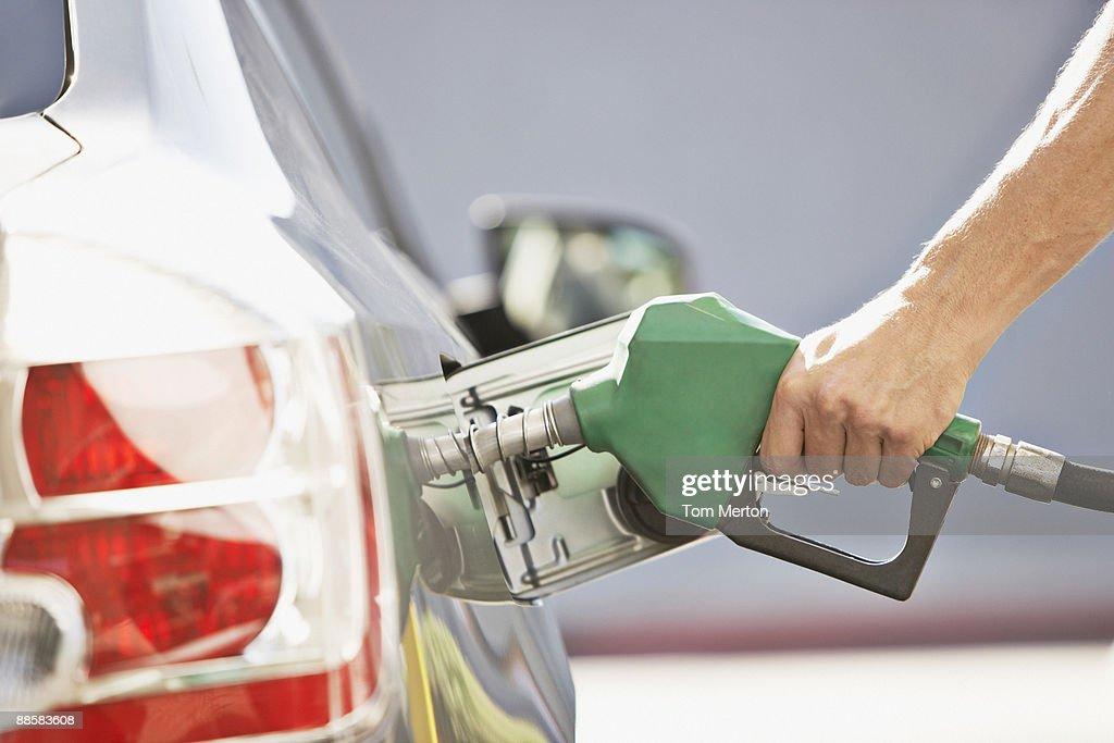 Man pumping gas : Stock Photo