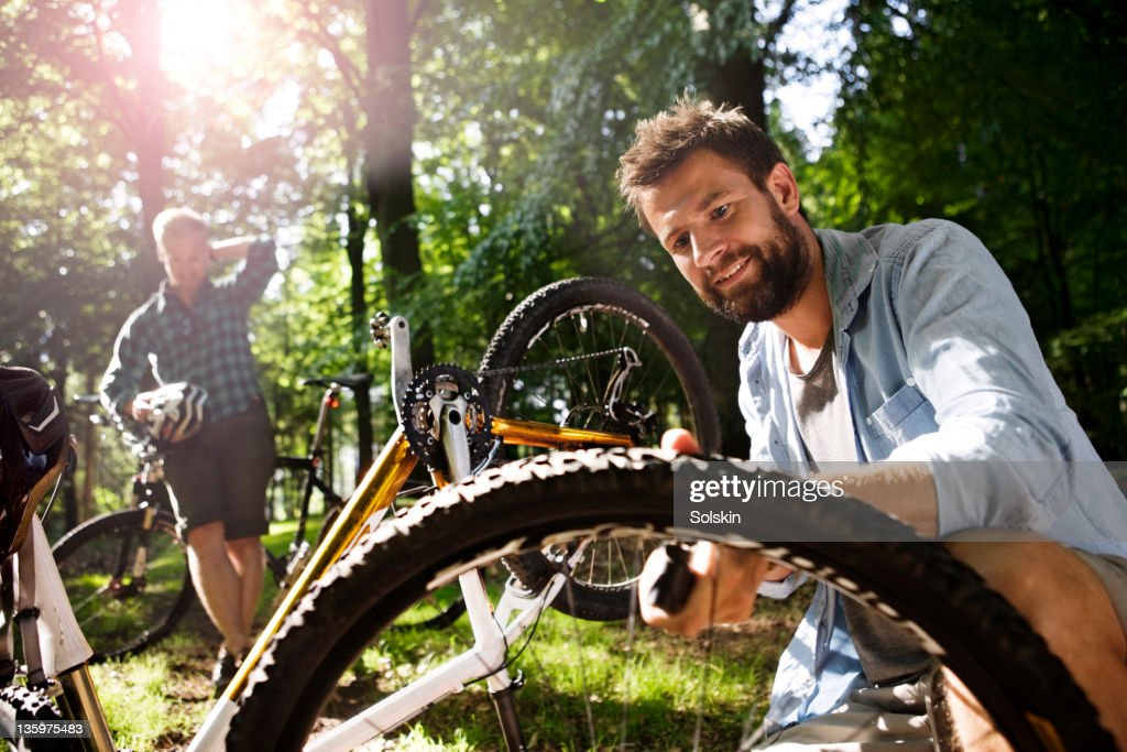 Man pumping moutainbike tire : Stock Photo