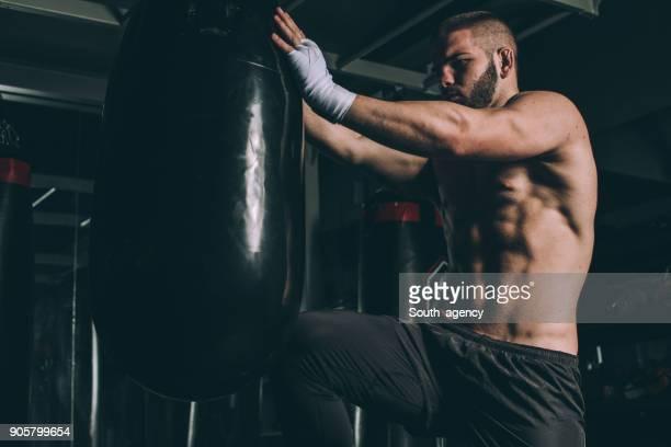 Man punching a bag on a boxing training